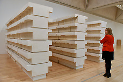 """© Licensed to London News Pictures. 11/09/2017. London, UK. A staff member views """"Untitled (Book Corridors)"""", 1997-8, at the preview of an exhibition featuring works by artist Rachel Whiteread at Tate Britain.  The exhibition spans her career over three decades and runs 12 September to 21 January 2018.   Photo credit : Stephen Chung/LNP"""