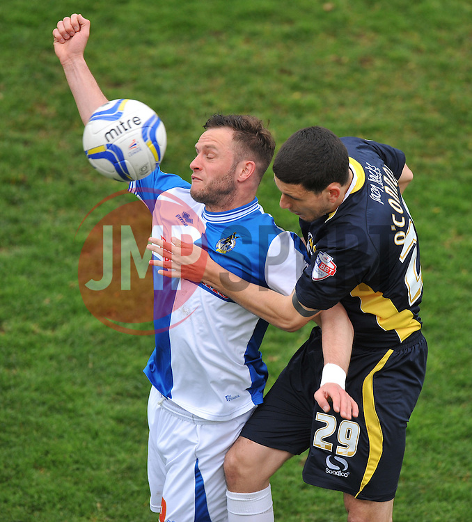 Bristol Rovers' Steven Gillespie battles for a high ball with Torquay United's Anthony O'Connor  - Photo mandatory by-line: Alex James/JMP - Mobile: 07966 386802 12/04/2014 - SPORT - FOOTBALL - Bristol - Memorial Stadium - Bristol Rovers v Torquay United - Sky Bet League Two