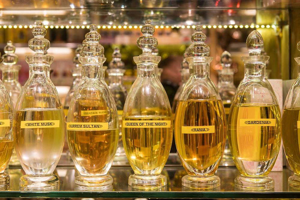 Beautiful glass bottles of perfume sitting on a shelf in Istanbul Spice bazaar in Turkey.