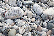Close up of rounded beach pebbles illustrating erosional process of attrition, Barra, Scotland, UK