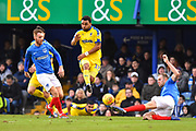 Andy Barcham (17) of AFC Wimbledon is tackled by Matt Clarke (5) of Portsmouth during the EFL Sky Bet League 1 match between Portsmouth and AFC Wimbledon at Fratton Park, Portsmouth, England on 1 January 2019.