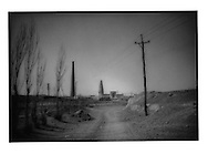 Before: Unsealed road leads to the unobstructed Emin Minaret and Mosque as seen in 1996, Turpan Oasis, Chinese Turkestan.