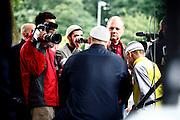 Dietzenbach | 24.07.2011..Am Samstag (24.07.2011) hielt der Salafist und radikale Islamist Pierre Vogel (Abu Hamza) in Dietzenbach (Landkreis Offenbach) vor etwa 200 Menschen einen Vortrag..Hier: Pierre Vogel, mit dem Ruecken zur Kamera, gibt Medien Interviews...©peter-juelich.com..[No Model Release | No Property Release]