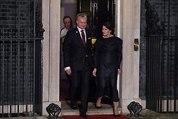 London, UK. 3 December, 2019. Gitanas Nausėda, President of Lithuania, leaves with his wife Diana Nausėdienė following a reception for NATO leaders at 10 Downing Street on the eve of the military alliance's 70th anniversary summit at a luxury hotel near Watford.