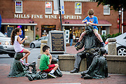 """Annapolis, Maryland - June 05, 2016: Siblings Maia Eissa, 8, left, and Adham Eissa, 9, middle, and Christopher (parents don't want his last name published) eat ice cream atop the Kunta Kinte-Alex Haley Memorial statue in historic Annapolis Sunday June 5th, 2016. Earlier that day a perigean spring tide brought some of the highest water levels of the year to the coastal town and partially flooded the park. <br /> <br /> A perigean spring tide brings nuisance flooding to Annapolis, Md. These phenomena -- colloquially know as a """"King Tides"""" -- happen three to four times a year and create the highest tides for coastal areas, except when storms aren't a factor. Annapolis is extremely susceptible to nuisance flooding anyway, but the amount of nuisance flooding has skyrocketed in the last ten years. Scientists point to climate change for this uptick. <br /> <br /> <br /> CREDIT: Matt Roth for The New York Times<br /> Assignment ID: 30191272A"""