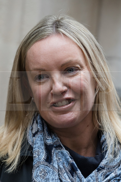 © Licensed to London News Pictures. 27/02/2017. LONDON, UK.  Gabby (Gabrielle) Kuehn leaves Mayor's and City of London court in London after losing the case with her husban, Florian Kuehn against their property management company, Victory Place. Gabby and Florian Kuehnn from Limehouse in east London claim they were told their pet dog, a Yorkshire terrier cross, Vinnie could live in their flat when they purchased it, but the management firm, Victory Place has subsequently insisted it has has a blanket no-pets policy. The animal rescue charity, All Dogs Matter are backing the couple and says no-pet rules see thousands of pets dumped each year and the rules are particularly unfair on the elderly and vulnerable who rely on pets for support and companionship. Photo credit: Vickie Flores/LNP