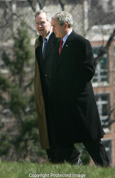 President George W.Bush  and  President H.W. Bush talk as they leave Marine One at the Naval Observatory to return to the White House.  Marine One landed at the Naval Observatory because the South Lawn on the White House is being prepared for the East Egg Roll on Monday, March 24, 2008.   Photo by Dennis Brack/Black Star