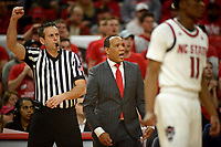 Men's basketball coach Kevin Keatts (center) calls out to players during 2nd half action against UVA.