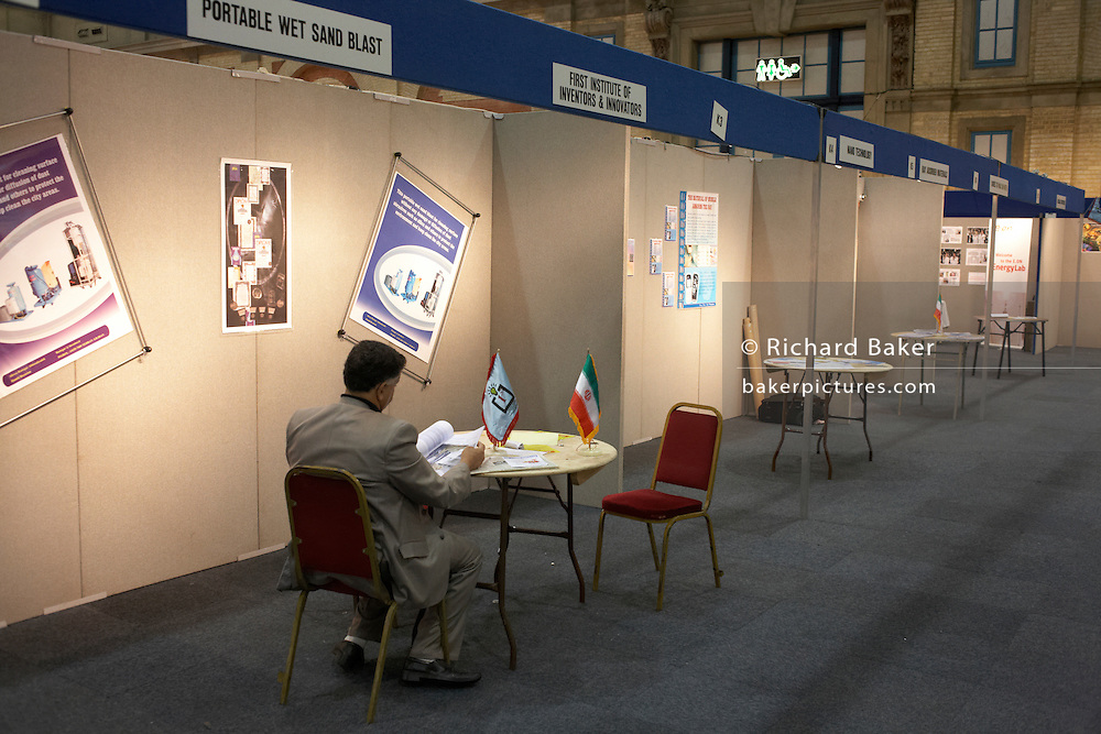 A patient Iranian entrepreneur awaits investment for his concept at an inventors fair in Alexandra Palace, London
