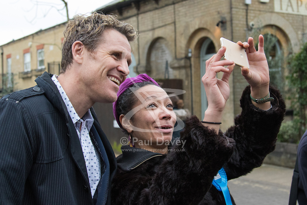 Kew, London, February 12th 2016. Conservative Mayor of London Candidate Zac Goldsmith holds a Q & A session for local residents at the Tap on the Line pub at Kew Gardens Station. PICTURED: Olympic rowing gold medalist James Cracknell poses for a selfie with one of Goldsmith's supporters. ///FOR LICENCING CONTACT: paul@pauldaveycreative.co.uk TEL:+44 (0) 7966 016 296 or +44 (0) 20 8969 6875. ©2015 Paul R Davey. All rights reserved.