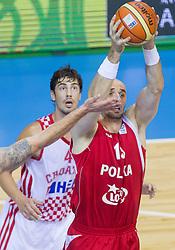 Damir Markota #12 of Croatia vs Marcin Gortat #13 of Poland during basketball match between National teams of Croatia and Poland in Round 1 at Day 4 of Eurobasket 2013 on September 7, 2013 in Arena Zlatorog, Celje, Slovenia. (Photo by Vid Ponikvar / Sportida.com)