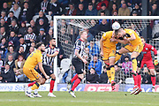Port Vale defender Kyle Howkins (33) and Port Vale defender Joe Davis (5) head the ball together during the EFL Sky Bet League 2 match between Grimsby Town FC and Port Vale at Blundell Park, Grimsby, United Kingdom on 10 March 2018. Picture by Mick Atkins.