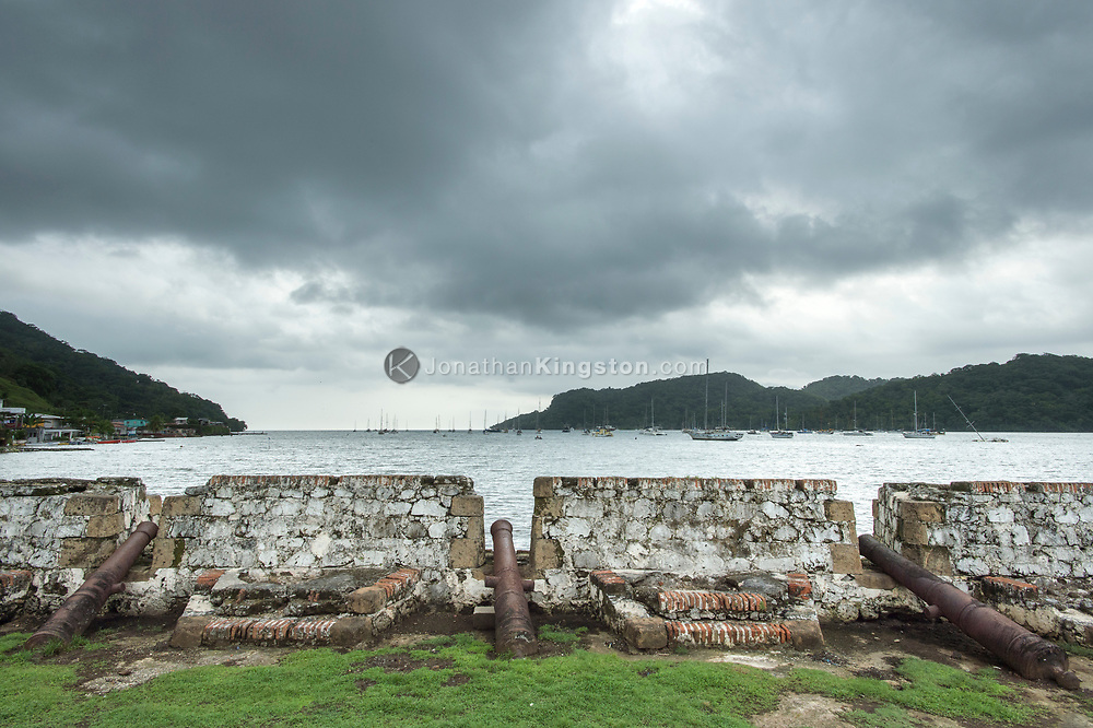 Cannons point into the bay of Portobelo from Fort San Jeronimo, Panama.