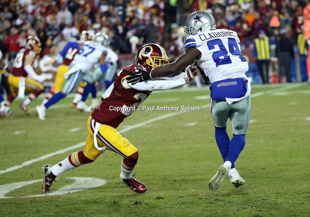 Dallas Cowboys cornerback Morris Claiborne (24) bumps Washington Redskins defensive back Dashaun Phillips (35) during the 2015 week 13 regular season NFL football game against the Washington Redskins on Monday, Dec. 7, 2015 in Landover, Md. The Cowboys won the game 19-16. (©Paul Anthony Spinelli)