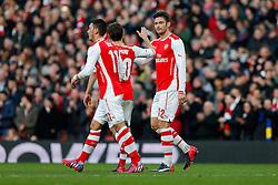 Olivier Giroud of Arsenal celebrates scoring a goal to make it 1-0 - Photo mandatory by-line: Rogan Thomson/JMP - 07966 386802 - 15/02/2015 - SPORT - FOOTBALL - London, England - Emirates Stadium - Arsenal v Middlesbrough - FA Cup Fifth Round Proper.