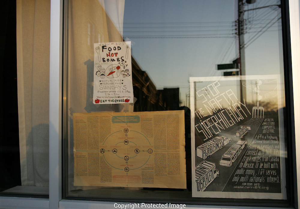 Posters in the window of the Sporeprint Infoshop on 5th Ave. (Jodi Miller/Alive)