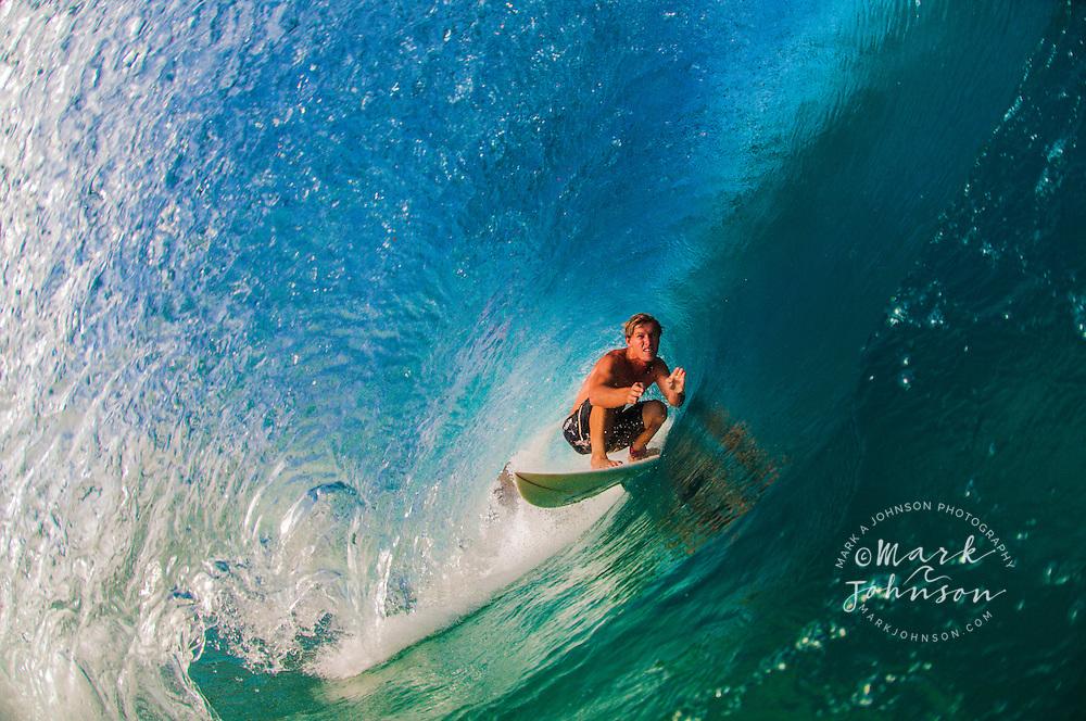 Surfer inside a tube at Main Beach, N. Stradbroke Island, Queensland, Australia