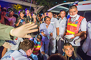 "10 NOVEMBER 2012 - BANGKOK, THAILAND:  Medics and nurses from the Ruamkatanya Foundation on the scene of a fatal accident involving a child near the Klong Toey slum in Bangkok. The Ruamkatanyu Foundation was started more than 60 years ago as a charitable organisation that collected the dead and transported them to the nearest facility. Crews sometimes found that the person they had been called to collect wasn't dead, and they were called upon to provide emergency medical care. That's how the foundation medical and rescue service was started. The foundation has 7,000 volunteers nationwide and along with the larger Poh Teck Tung Foundation, is one of the two largest rescue services in the country. The volunteer crews were once dubbed Bangkok's ""Body Snatchers"" but they do much more than that now.    PHOTO BY JACK KURTZ"