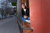 EL ABOGADO ALEJANDRO MELLANA SENTADO EN LA VENTANA CON REJAS DE SU ESTUDIO EN INGENEIERO MASCHWITZ, PROVINCIA DE BUENOS AIRES, ARGENTINA (PHOTO © MARCO GUOLI - ALL RIGHTS RESERVED)
