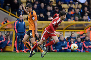 Middlesbrough striker Diego Fabbrini skips away from Wolverhampton Wanderers midfielder Conor Coady during the Sky Bet Championship match between Wolverhampton Wanderers and Middlesbrough at Molineux, Wolverhampton, England on 24 October 2015. Photo by Alan Franklin.