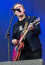 © Licensed to London News Pictures. 30/08/2015. Reading, UK. The Gaslight Anthem performing at Reading Festival 2015, Day 3 Sunday.  In this picture - Brian Fallon.  Photo credit: Richard Isaac/LNP