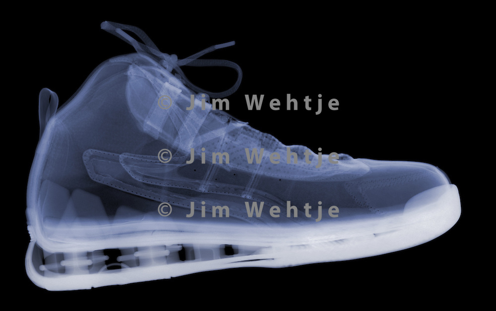 X-ray image of an athletic shoe (side view, blue on black) by Jim Wehtje, specialist in x-ray art and design images.
