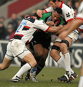Twickenham, GREAT BRITAIN, Quins, Centre, Jordan TURNER-HALL attemts to charge through the gap left Neil DE KOCK and Ongaro FABIO, during the Guinness Premiership game Harlequins [Quins] vs Saracens at the Stoop, Middx, 22/12/2007  [Mandatory Credit Peter Spurrier/Intersport Images]