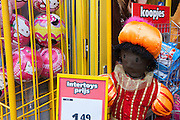 Zwarte Piet toy in a toyshop in Knokke, Flanders, Belgium. Sinterklaas, the basis for Santa Claus in other countries, arrives from Spain by boat, accompanied by Black Peter, played by multitudes of white Dutch people in blackface - a tradition that evokes some controversy. Contrary to traditions of Santa Claus elsewhere, Sinterklass arrives by boat, then rides through the streets on his grey horse, Amerigo, in mid-November, bringing in the Christmas season. The Zwarte Pieten (Black Peters) distribute sweets and gingerbread cookies to the crowd along the parade route.