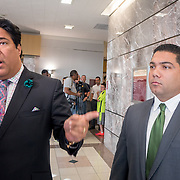 FORT LAUDERDALE, FLORIDA, DECEMBER 21, 2015<br /> Suspended Broward Sheriff's deputy Peter Peraza listens as his attorney, Eric Schwartzreich, talks to a tv station reporter outside the courtroom following a brief court appearance. Peraza faces manslaughter charges in the shooting death of Jermaine McBean, 33, in July of 2013.<br /> (Photo by Angel Valentin/Freelance).