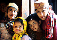 Pakistan, Sehwan Sharif, 2004. At the eastern door of the shrine of Hazrat Lal Qalander, new friends with shy smiles and curiosity to spare.