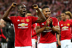 Eric Bailly and Antonio Valencia of Manchester United celebrate at full time - Mandatory by-line: Matt McNulty/JMP - 26/02/2017 - FOOTBALL - Wembley Stadium - London, England - Manchester United v Southampton - EFL Cup Final