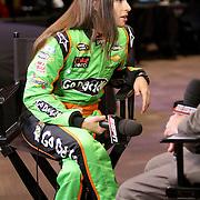 Driver Danica Patrick prepares for a TV interview during the NASCAR Media Day event at Daytona International Speedway on Thursday, February 14, 2013 in Daytona Beach, Florida.  (AP Photo/Alex Menendez)
