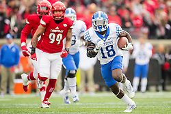 Kentucky running back Stanley Williams finds a seam to run in the first half. The University of Louisville hosted Kentucky, Saturday, Nov. 26, 2016 at Papa John's Cardinal Stadium in Louisville. Kentucky won the game 41-38.