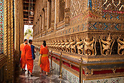 Visiting Buddhist monks at  Wat Phra Kaeo, The Temple of the Emerald Buddha, on the grounds of The Grand Palace in Bangkok, Thailand.