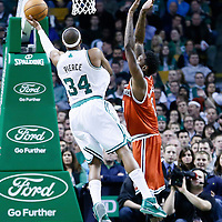 21 December 2012: Boston Celtics small forward Paul Pierce (34) goes for the layup past Milwaukee Bucks center Larry Sanders (8) during the Milwaukee Bucks 99-94 overtime victory over the Boston Celtics at the TD Garden, Boston, Massachusetts, USA.