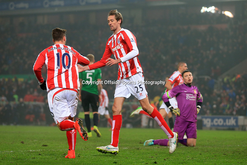 4th January 2015 - FA Cup - 3rd Round - Stoke City v Wrexham - Marko Arnautovic of Stoke (L) celebrates with teammate Peter Crouch after scoring their 1st goal - Photo: Simon Stacpoole / Offside.