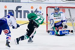 John Hughes (HDD Tilia Olimpija, #72) vs Bernhard Starkbaum (EC Rekord-Fenster VSV, #29) during ice-hockey match between HDD Tilia Olimpija and EC Rekord-Fenster VSV in 31st Round of EBEL league, on December 28, 2010 at Hala Tivoli, Ljubljana, Slovenia. (Photo By Matic Klansek Velej / Sportida.com)