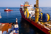 Russia, Sakhalin, Sea of Okhotsk The oil service vessel Normand Oceanic delivering supplies and parts to Skandi Hercules.
