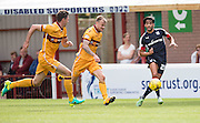 Dundee's Faissal El Bakhtaoui races away from Motherwell's Richard Tait and Ben Heneghan - Motherwell v Dundee in the Ladbrokes Scottish Premiership at Fir Park, Motherwell. Photo: David Young<br /> <br />  - © David Young - www.davidyoungphoto.co.uk - email: davidyoungphoto@gmail.com