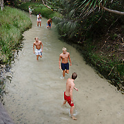 Frazer Island, on the east coast of Australia, is a sand island. Eli CreeK. Young men.