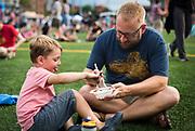 Everett and Zack Wyatt enjoy Dough Baby Bakery's dessert during the 4th annual Yum Yum Fest held at Breese Stevens Field, Sunday, August 6, 2017.