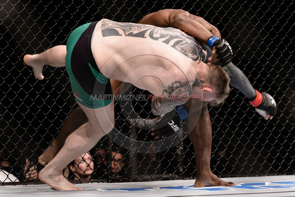 "GLASGOW, UNITED KINGDOM, JULY 16, 2017: Galore Bofando (black trunks) versus Charlie Ward during ""UFC Fight Night Glasgow: Nelson vs. Ponzinibbio"" inside the SSE Hydro Arena in Glasgow, Scotland on Sunday, July 16, 2017."