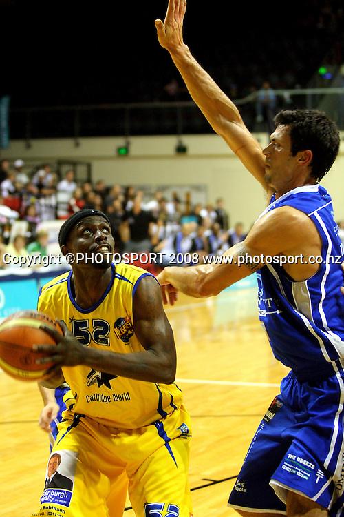 Lemar Gayle tries to shoot past Arthur Trousdell.<br /> NBL Basketball. Wellington Saints v Otago Nuggets, TSB Bank Arena, Wellington. Sunday, 30 March 2008. Photo: Dave Lintott/PHOTOSPORT