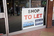 Empty shop with To Let estate agent sign, Newmarket, Suffolk, England