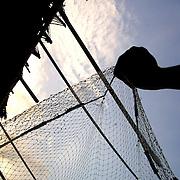 Benin November 27, 2001 - Beninese fisherman in northem of Cotonou cheks an hold fishing net