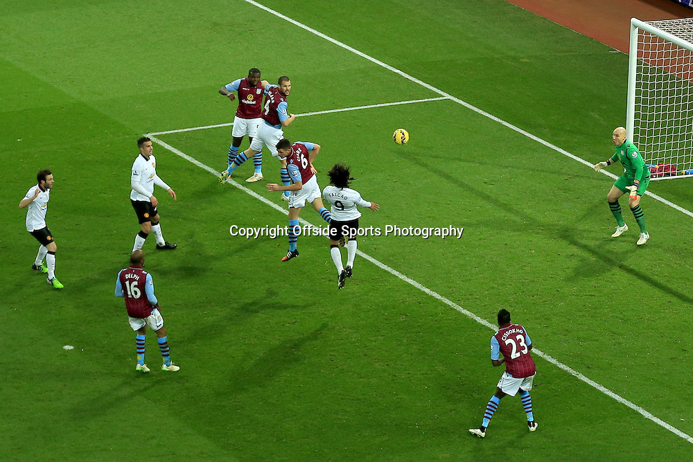 20 December 2014 - Barclays Premier League - Aston Villa v Manchester United - Radamel Falcao of Manchester United leaps to head the ball over Aston Villa goalkeeper, Brad Guzan for the equalising goal - Photo: Marc Atkins / Offside.