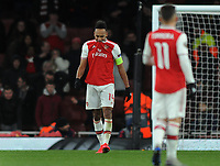 Football - 2019 / 2020 UEFA Europa League - Round of Thirty-Two, Second Leg: Arsenal (1) vs. Olympiakos (0)<br /> <br /> A dejected Pierre - Emerick Aubameyamg of Arsenal, bits his shirt after missing from close range to win the match at the Emirates Stadium.<br /> <br /> COLORSPORT/ANDREW COWIE