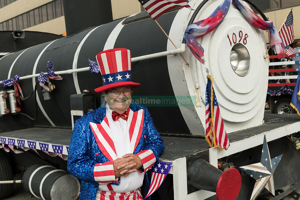 July 4, 2018 - Anchorage, AK, Canada - A man dressed as Uncle Sam stands by a parade float decorated as a steam train engine during the annual Independence Day parade July 4, 2018 in Anchorage, Alaska. (Credit Image: © Richard Ellis/Planet Pix via ZUMA Wire)