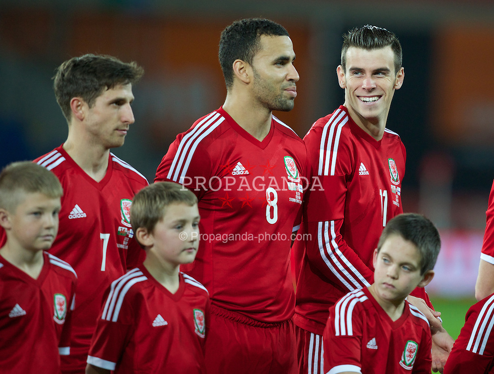 CARDIFF, WALES - Saturday, November 16, 2013: Wales' Gareth Bale smiles as the teams line up before the International Friendly match against Finland at the Cardiff City Stadium. (Pic by Kieran McManus/Propaganda)