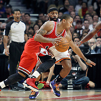 12 March 2012: Chicago Bulls point guard Derrick Rose (1) drives past New York Knicks point guard Baron Davis (85) during the Chicago Bulls 104-99 victory over the New York Knicks at the United Center, Chicago, Illinois, USA.